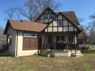 home addition with brown trim