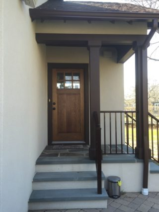 home addition with wood door