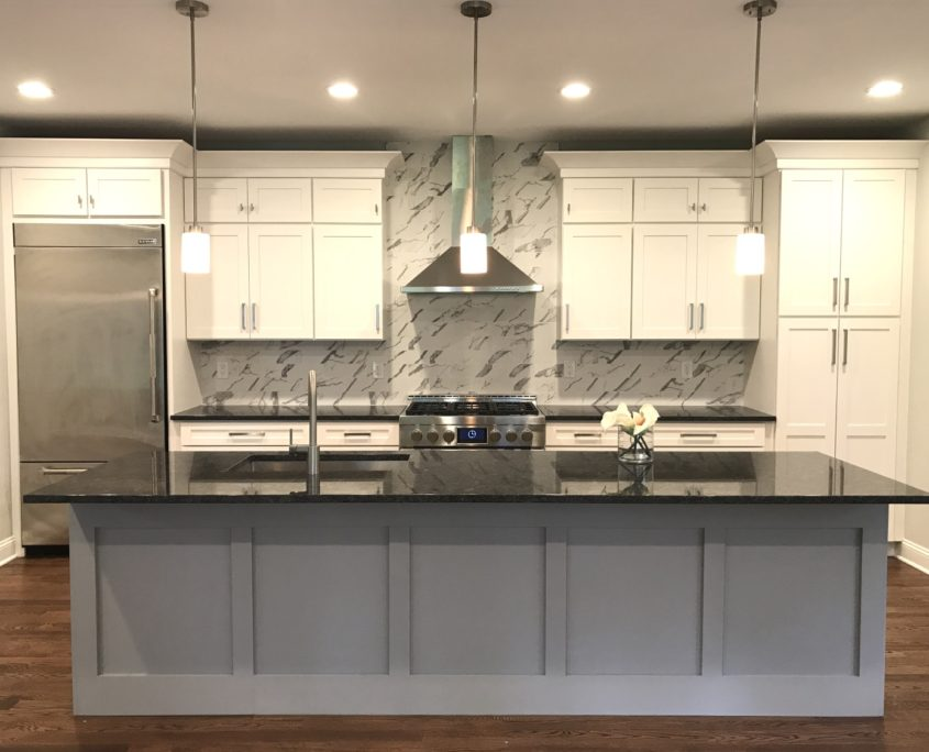 kitchen remodel with marble countertops and backsplash