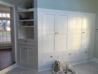mudroom with white cabinets and chrome hardware