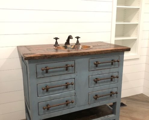 Refurbished dresser for sink with barnwood and copper sink