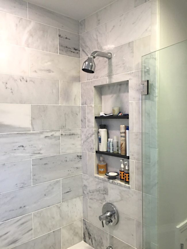 bathroom remodel with subway tile shower