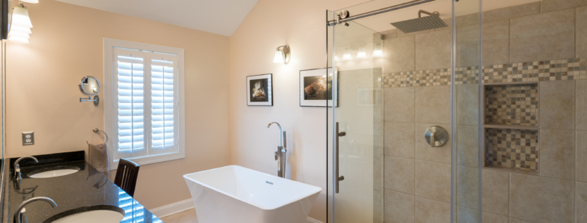 walk-in shower with sliding glass doors
